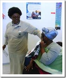 Community based eye care worker screening eyes during eye wellness day