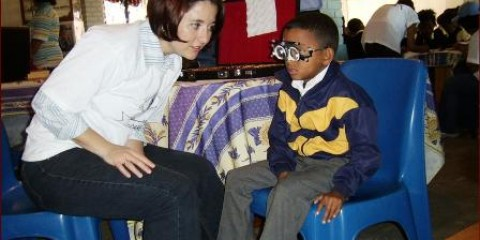 Young boy with high myopia receiving an eye test