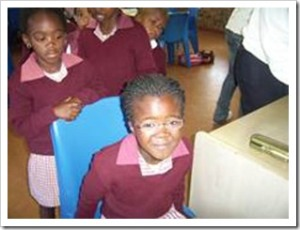 Young pupil receiving and eyetest at the Jonga refraction day camp