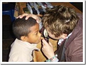 Young schoolboy receiving an eye test during the Jonga Sterkinekor Vision Mission day